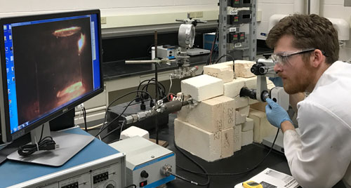 Graduate student Tim Duffy is aligning electrodes before taking electrophoretic measurements.
